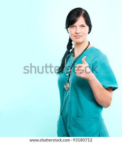 Female doctor wearing green scrubs, added copy space - stock photo