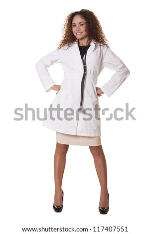 Female Doctor with a friendly smile poses with her hands on her hips, isolated on white background. - stock photo