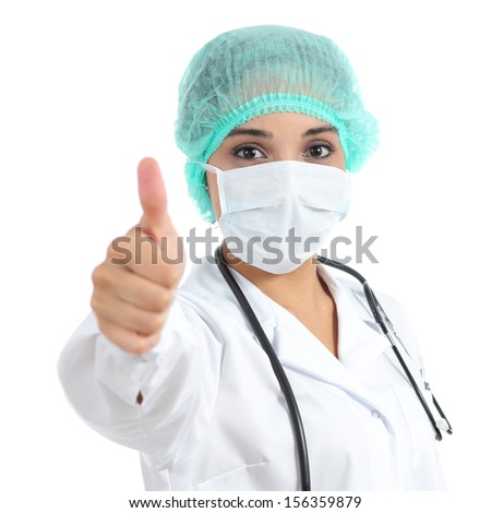 Female doctor with a surgical mask with thumb up isolated on a white background