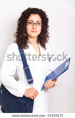female doctor with clipboard  and bag