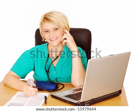 female doctor with laptop and blood pressure device