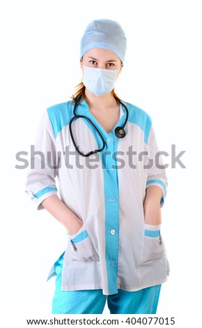 Female doctor with medical mask on face with hands in pockets, look at camera , isolated on white background