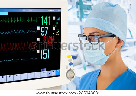 Female doctor with monitor in intensive care unit. - stock photo