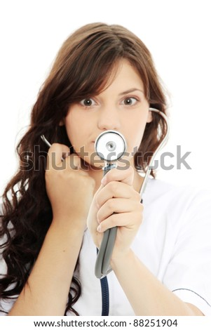 Female doctor with stethoscope isolated on white background - focus on stethoscope - stock photo