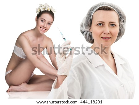 Female doctor with syringe stands near patient - stock photo
