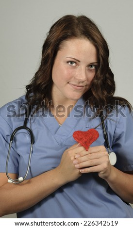 Female doctor with the stethoscope with a heart - stock photo