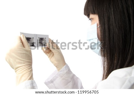 female doctor with x-ray dental film - stock photo