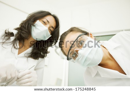 female doctors checking a patient - stock photo