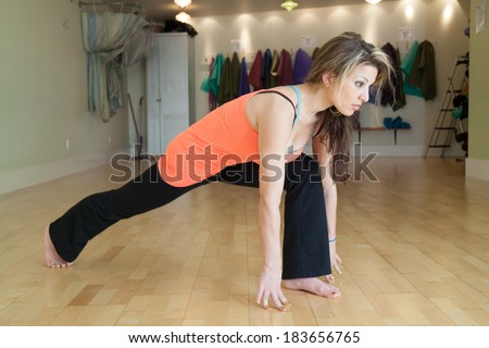 female doing yoga in a studio  - stock photo