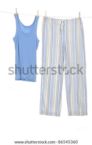 female dress blue shirt and trousers clothespins on rope - stock photo