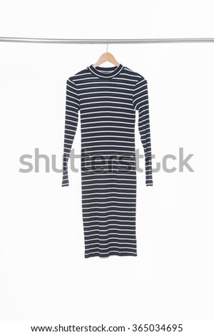 female dress on a wooden hanger, isolated on white  - stock photo
