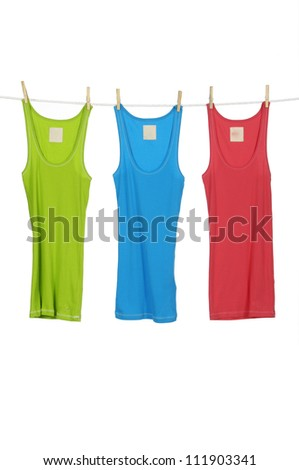 female dress red and blue ,green shirt clothespins on rope - stock photo