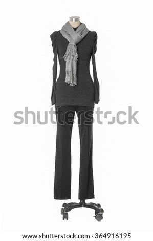 female dress with scarf and trousers on n mannequin-white background
