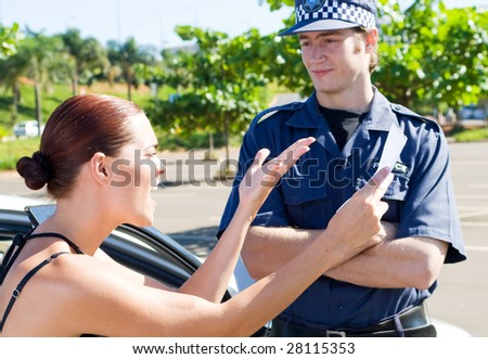 female driver angry at a traffic police over a ticket - stock photo