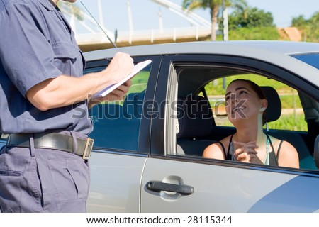female driver begging traffic police not to write a ticket - stock photo