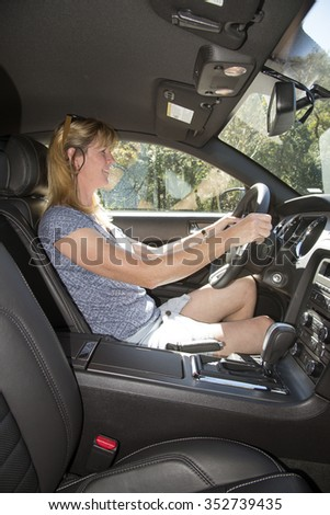 Female driver in a left hand drive American car