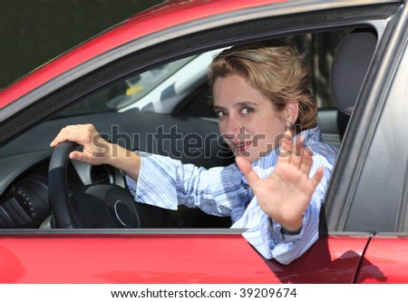 "Female driver saying ""Goodbye"" and leaving."