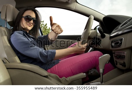 Female Driver Thumbs Up - stock photo