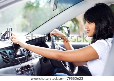 female driver using GPS navigator