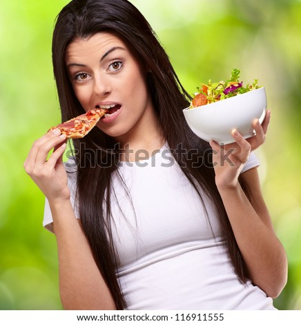 Female Eating A Piece Of Pizza And  Holding A Salad Bowl , Background