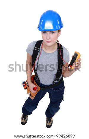 Female electrician taking reading - stock photo