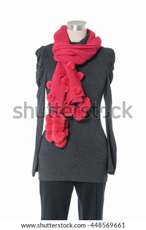 female elegant dress with red scarf and trousers on n mannequin  - stock photo