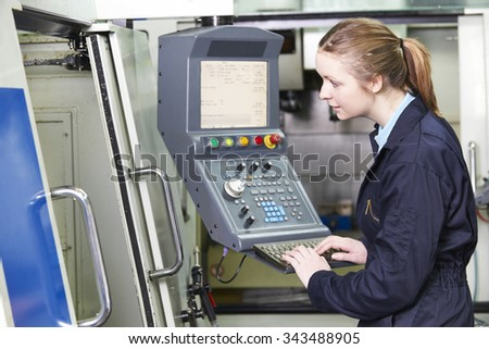 Female Engineer Operating Computerized Cutting Machine