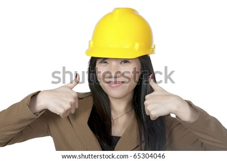 Female Engineer wearing yellow helmet show two thumbs up isolated over white background
