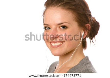 Female Enjoying Music - This is a photo of a cute young woman ready to listen to some music on her iPod. Shot on an isolated white background with a shallow depth of field. - stock photo
