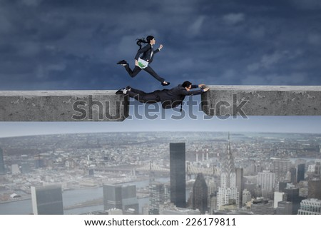 Female entrepreneur carrying chart and running above her colleague to chase their target - stock photo