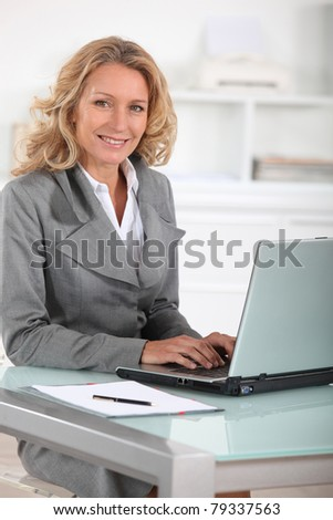 Female executive at laptop computer - stock photo