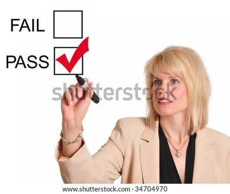 Female executive checking the pass box on a whiteboard - stock photo