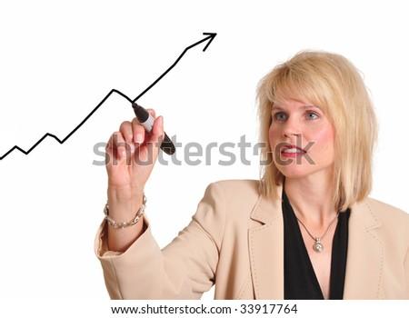 Female executive drawing trend line upward - stock photo