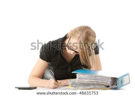 Female executive filling out tax forms while sitting at her desk. Isolated on white - stock photo
