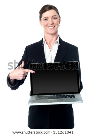 Female executive promoting a brand new laptop