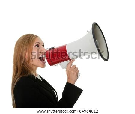 Female executive yelling through a megaphone - stock photo