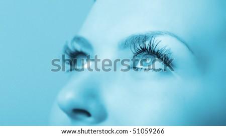 Female eye close up. A blue tonality. Selective focus - stock photo
