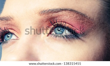 female eye closeup with makeup