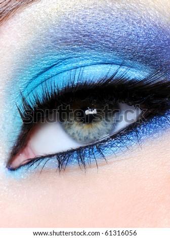 Female eye with bright blue makeup - macro shot - stock photo