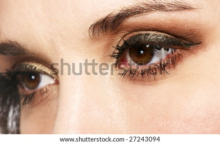 female eye with golden-brown cosmetic make-up