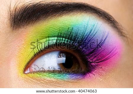 Female eye with rainbow make-up and long eyelashes - stock photo
