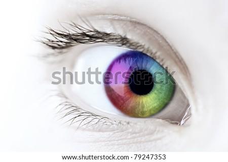 Female eye with rainbow multicolored iris close up - stock photo