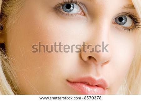 female face closeup, studio shot - stock photo