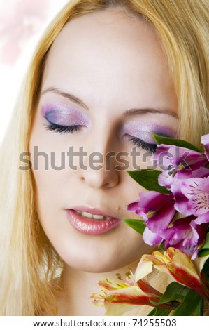 Female face with healthy skin and closed eyes  closeup, creative makeup  and spring flowers. Skincare, spa and floral concept. - stock photo