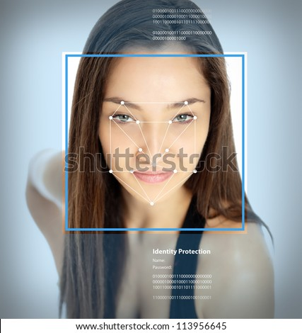 Female face with lines from a facial recognition software - stock photo