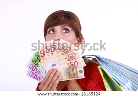 Female face with much money - stock photo
