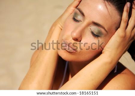 Female face with stone lips sunbathing - stock photo