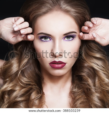 Female Face. Woman with Fashion Hairstyle and Makeup - stock photo