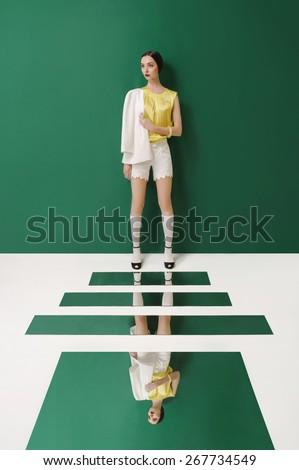Female fashion concept. Fashion girl posing on green background.  - stock photo