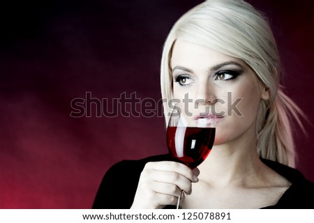female fashion model,blond hair holding glass of rose wine - stock photo